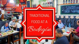 Eating Traditional Argentinian Food At A Bodegn In Buenos Aires, Argentina