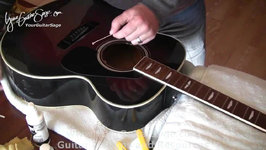 Changing Strings on an Acoustic Guitar - Part 1 - Easy Video